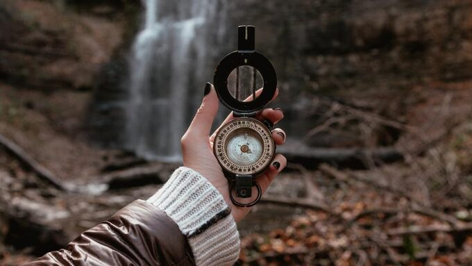 wide-shot-of-compass-and-waterfalls.jpg